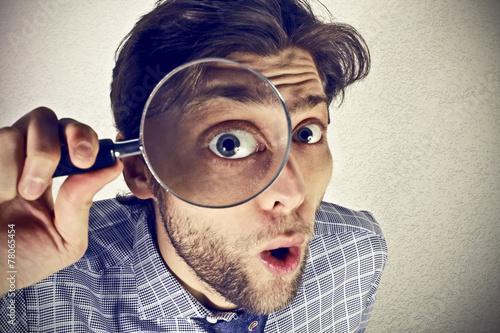 Fotografie, Tablou  Businessman looks through a magnifying lens