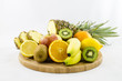 Fruits composition on wooden board with cut fruits