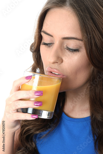 Valokuva  Attractive Young Woman Drinking Orange Juice