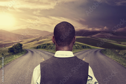 businessman in front of two roads hoping taking chance Canvas Print