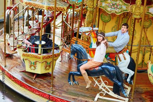 Valokuva  Happy couple on the merry-go-round in Paris