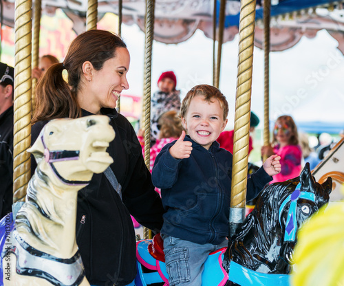 Poster Amusementspark Happy Boy and Mother on Carousel