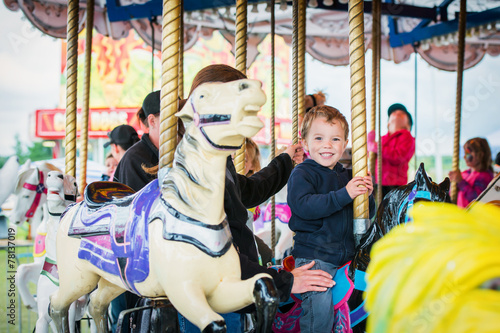Poster Amusementspark Excited Boy on a Carousel Horse