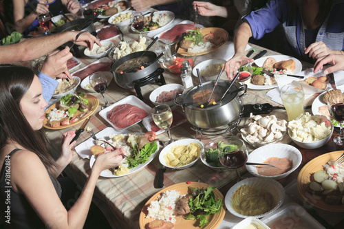 A fondue dinner with friend on a beautiful place Poster Mural XXL