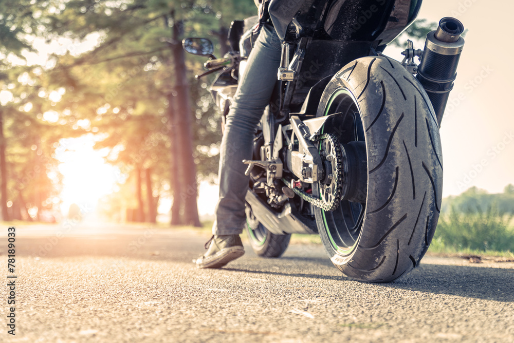 Fototapeta biker and motorbike ready to ride