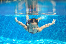 Kid Swims In Pool Underwater, Girl Swimming Having Fun