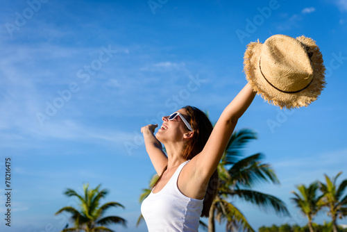 Woman enjoying tropical vacation travel and freedom Canvas Print