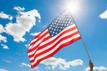 American Flag Waving In Blue S...