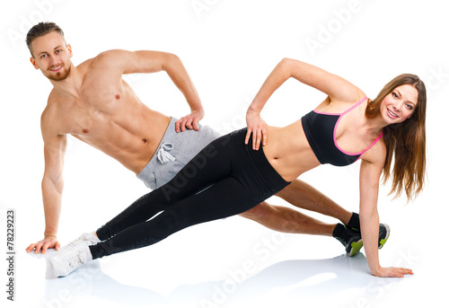 Fotografie, Obraz  Sport attractive couple - man and woman doing fitness exercises