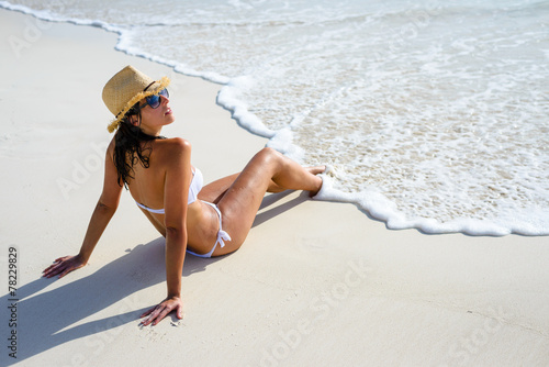 Woman on relaxing summer vacation tanning
