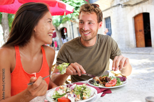 Restaurant tourists couple eating at outdoor cafe