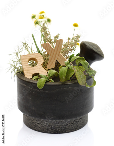 Fotografia  Mortar with fresh herbs and wooden letters RX isolated on white
