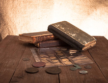 Vintage Books And Coins On Old...