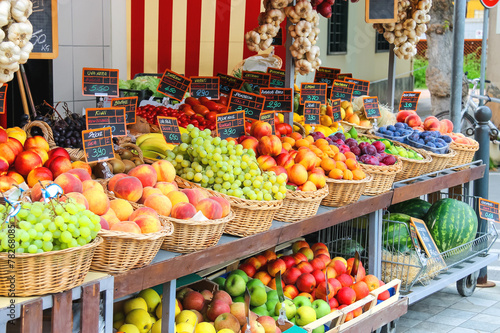Fotografia, Obraz Fruit stall in the Italian city market
