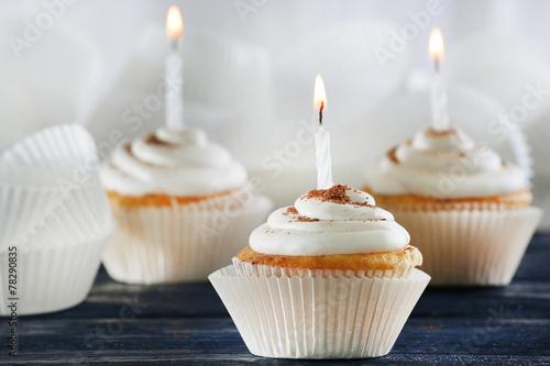 Fotografia, Obraz  Delicious birthday cupcakes on table on light background