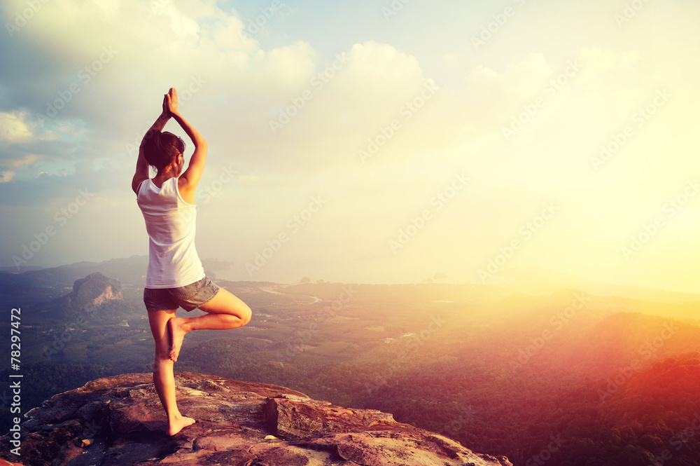 Fototapeta yoga woman meditation on mountain peak