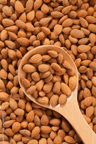 Poster Pays d Europe Almond background with large spoon full with fruits