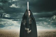 Beautiful Dark Woman In A Desert Landscape