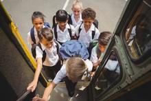 Cute Schoolchildren Getting On...