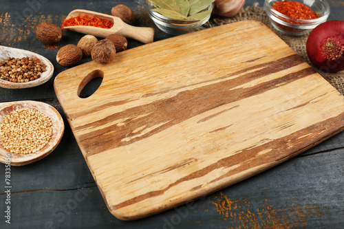 Poster Cuisine Different spices and herbs with cutting board