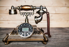 Old Telephone On Wooden Background. Copy Space On The Bottom.
