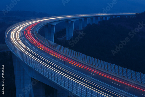 Acrylic Prints Night highway Blurred lights of vehicles