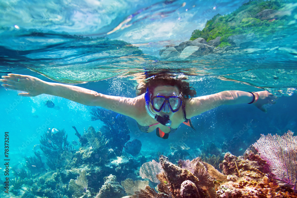 Fototapeta Young women at snorkeling in the tropical water