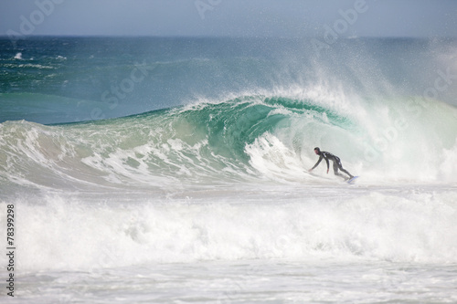 Surfer riding large wave #78399298