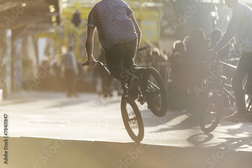 Poster Cycling Anonymous bmx biker doing a stunt