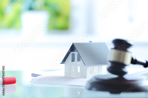 Photo Conceptual White Little House on Top of Documents