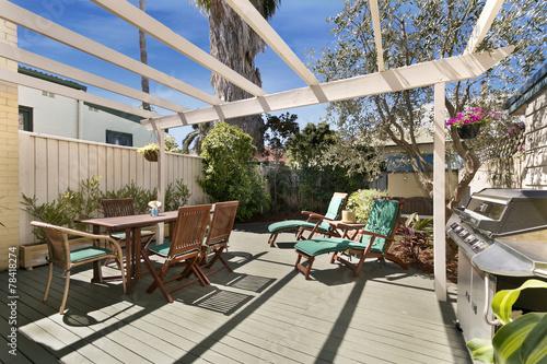 Staande foto Industrial geb. backyard cozy patio area with wicker furniture set