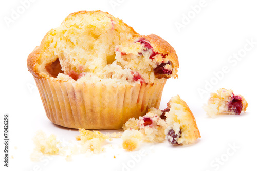 Photo Cranberry muffin on a white background broken