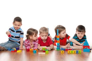 Fototapeta samoprzylepna Five children in kindergarten