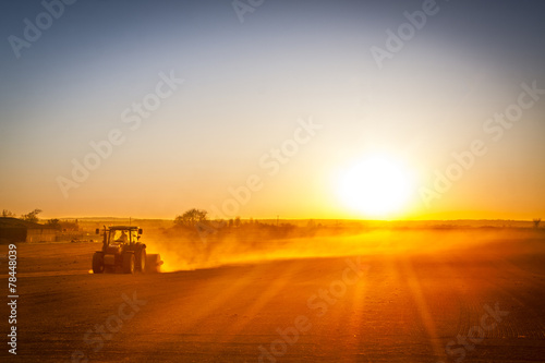 Farmer preparing his field in a tractor ready for spring