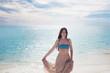 The beautiful girl in blue bikini.