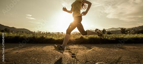 Fototapeta Fit woman running fast obraz