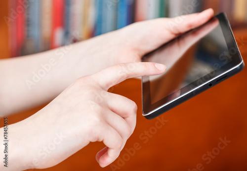 Fototapeta finger clicking touchpad screen in library obraz na płótnie