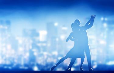 Fototapeta Romantic couple dance. Elegant classic pose. City nightlife