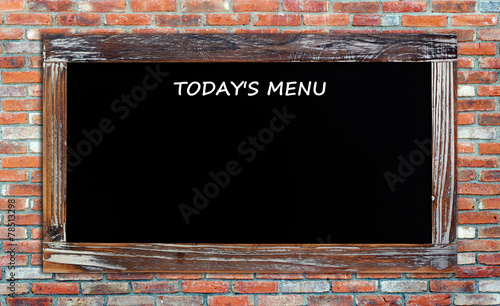 Canvas Print Today's menu on vintage chalk board over brick wall background