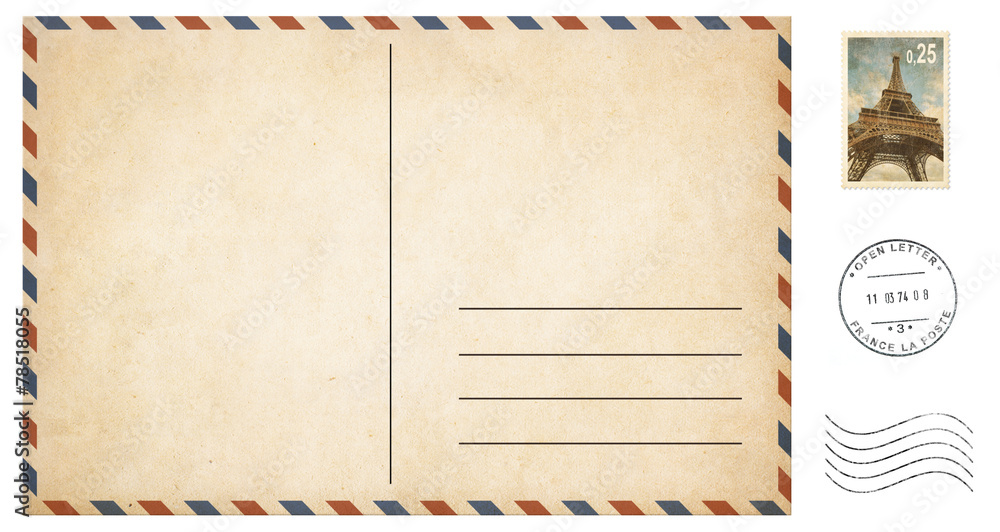 Fototapeta old blank postcard isolated on white with post stamps set