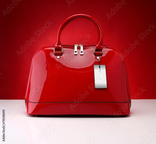 Obraz Red handbag on a red background - fototapety do salonu