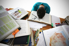 Medical Student Sit At The Desk, Study Medical Literature, Take An Exam. Stressed And Tired Young Male