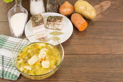 Fotobehang Zuivelproducten soup with dumplings and ham
