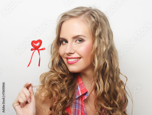 happy blond woman with little red heart