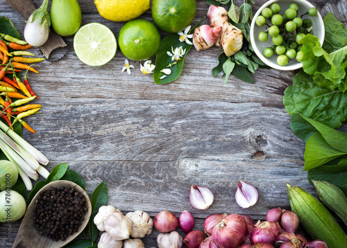 Fotografía  ingredient spices on grain wood background
