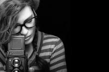 Young Woman Capturing Photo Using Vintage Camera. Monochrome Por