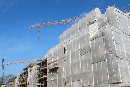 Foto op Plexiglas Stadion eingepackter Rohbau