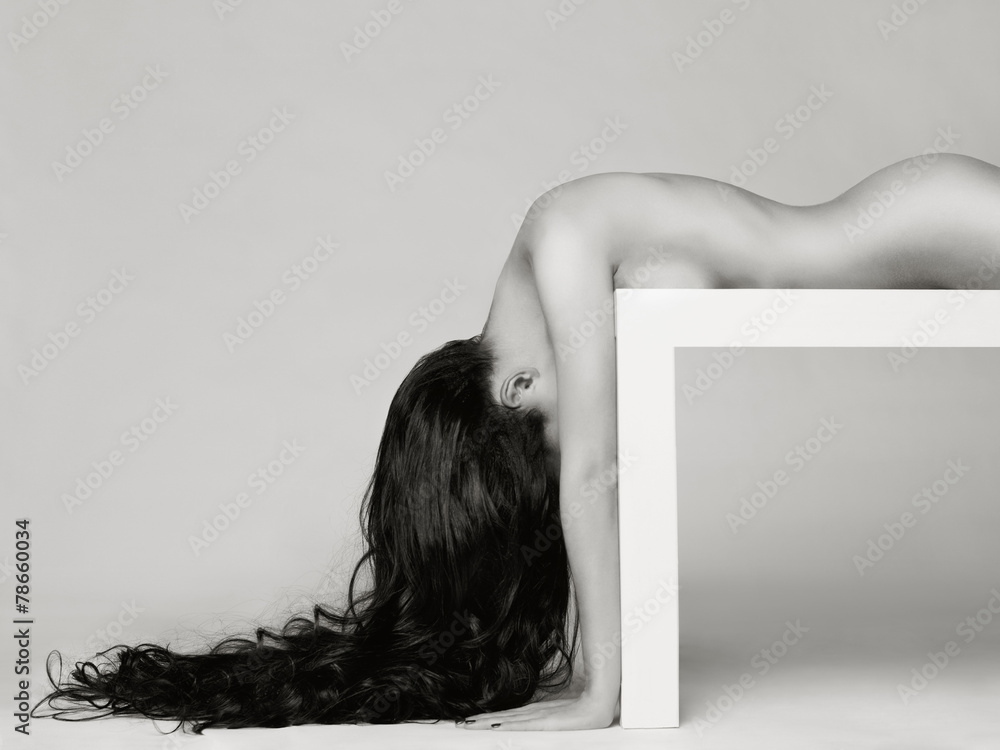 Valokuva  Elegant naked lady with long healthy hair