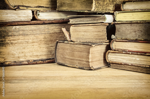 Valokuva  Sepia toned image of old books on a table