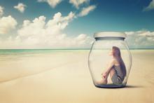 Woman Sitting In Jar On Beach Looking At The Ocean View